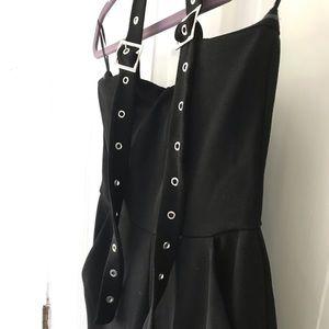 Black zip up jumpsuit w/ a metal clasp halter!!